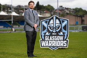 Glasgow Warriors managing director Nathan Mombrys unveils the club's new badge at Scotstoun. Picture: SNS/SRU.