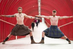 Finlay Wilson (right) and Tristan Cameron-Harper show off their yoga skills in Glasgow. Picture: John Devlin