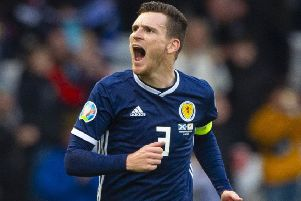 Andy Robertson celebrates opening the scoring for Scotland against Cyprus.