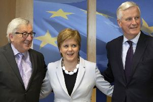 First Minister Nicola Sturgeon with European Commission President Jean-Claude Juncker, left, and European Union chief Brexit negotiator Michel Barnier. Picture: AP Photo/Virginia Mayo