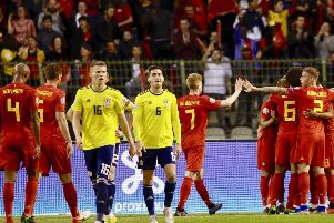 Dejection for Scott McTominay and Kenny McLean as Belgium celebrate scoring their second goal