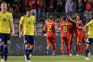 Brussels pouts: Belgium celebrate Romelu Lukaku's opener as Scott McTominay and Scott McKenna look dejected