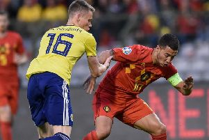 Scotland midfielder Scott McTominay vies for possession with Belgium's Eden Hazard. Picture: John Thys/AFP/Getty Images