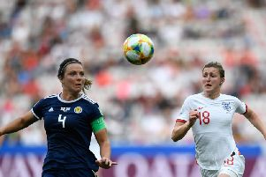 Scotland defender Rachel Corsie (left) vies for the ball with England's Ellen White during their World Cup clash