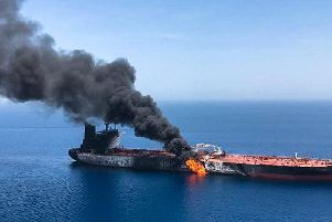 Fire and smoke billows from a Norwegian-owned oil tanker reportedly attacked near the Persian Gulf