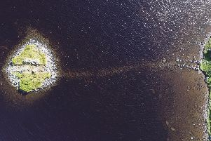 An aerial view of the crannog at Loch Bhorgastail, which shows the stone causeway leading to the site. PIC: Fraser Sturt.