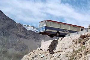 The coach was used in the scene where it was dangled over the cliff edge, while interiors were filmed in London. The Bus was later bought by  racing driver Archie Cromar and converted  into a transporter for his Formula Ford racing car.