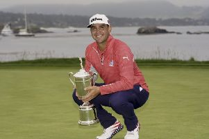 Gary Woodland posses with the trophy after winning the 119th US Open at Pebble Beach on the California coast. Picture: AP