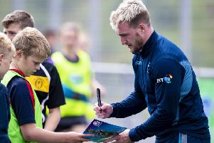 Scotland full-back Stuart Hogg signs an autograph for a fan in Inverness, where Gregor Townsend's extended training squad gathered to kick off their preparations for the World Cup. Picture: SNS/SRU
