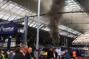 Smoke from the train which triggered fire alarms at Queen Street Station. Picture: Holly Rumble