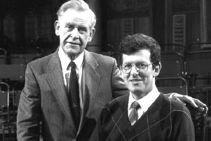 Hamish Cameron poses for a picture in the famous black chair with then Mastermind host Magnus Magnusson in 1990