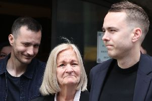 Sally Challen, flanked by her sons James (left) and David (right),  leaves court after hearing she will not face a retrial over the death of her husband Richard Challen in 2010. (Picture: Yui Mok/PA Wire)