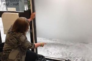 Waves were lapping up against Christine Jardine's office.