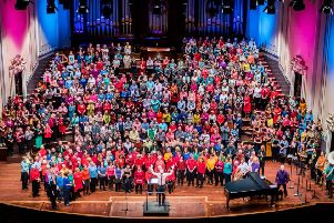 The massed ranks of the Love Music Community Choir and Junior Choir at the Usher Hall