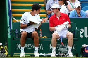 Andy Murray, right, and Marcelo Melo talk tactics, but it was in vain as they lost their match at Eastbourne. Picture: Getty (for LTA)