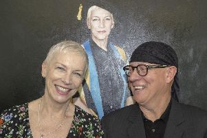Annie Lennox with artist Gerard Burns. Picture: PA/Glasgow Caledonian University