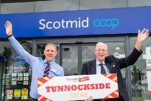 Campbell Lochie, Scotmid Tannochsides store manager, and Tunnocks managing director Sir Boyd Tunnock. Picture: Ian Georgeson
