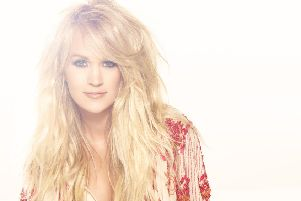 Carrie Underwood looks like Dolly Parton, and has the voice to match