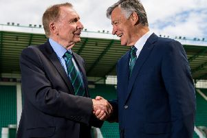 New Hibs chairman Ron Gordon shakes hands with Sir Tom Farmer. Picture: SNS
