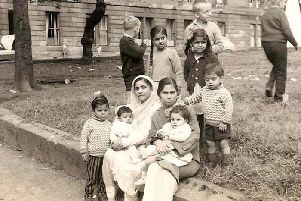 The Bhatti and Sadiq family gathered outside on Grafton Square, Glasgow  circa 1967. PIC: Bhatti family.