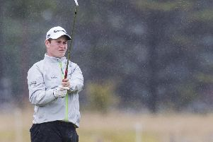 Robert MacIntyre practises in the rain. Picture: Bruce White/SNS