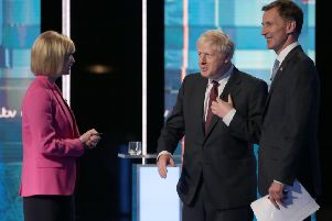 Julie Etchingham with Boris Johnson and Jeremy Hunt. (Photo by Matt Frost/ITV via Getty Images)