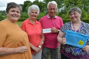 Jim and Nessie Cowie, with daughter Jacqueline Lyons (left), hand over the �400 cheque to Parkinson's nurse specialist Kay Mair
