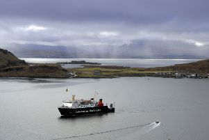A Caledonian MacBrayne ferry slips in past Kerrera, with Mull in the misty background (Picture: Donald MacLeod)