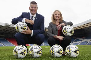 SPFL chief executive Neil Doncaster donated 100 Mitre Delta Max Plus footballs to women's chief executive Fiona McIntyre. Picture: Ross Brownlee/SNS