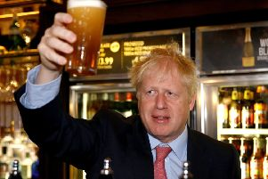 Boris Johnson holds up a beer as he meets JD Wetherspoon chair and Brexit fan Tim Martin (Picture: Henry Nicholls WPA Pool/Getty Images)