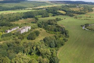 Dalquharran Castle and the original ruined medieval tower house have come on the market for offers over 800.000. PIC: Rettie & Co.