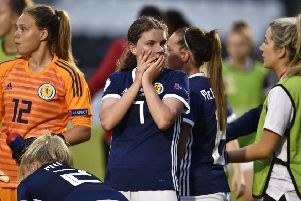 Kirstie McIntosh, centre, cuts a dejected figure after Scotland U19s' hopes of earning a draw were dashed by a late French strike.