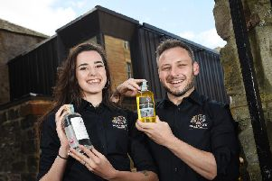 Holyrood Distillery visitor centre staff Rebecca Orr and oin  Murch prepare for the launch. Picture: Greg Macvean