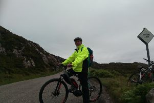 Alastair Dalton tries out an Assynt Development Trust electric bike on the North Coast 500 north of Lochinver. Picture: The Scotsman