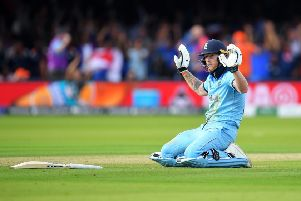 Ben Stokes holds his hands up after the ball, thrown by a fielder as he ran for the crease, hit his bat, then went out for four runs in the World Cup final against New Zealand (Picture: Clive Mason/Getty Images)