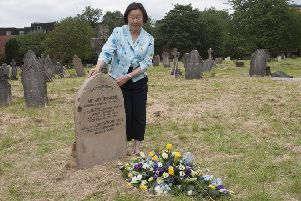 Betty Yao at Thomson's restored grave. Picture: The Wellcome Library