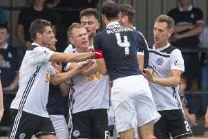 Tempers flare at Somerset Park as Falkirk are awarded a penalty. Picture: SNS