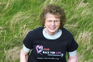 Trish Godman, seen here promoting Cancer Research's Race for Life, became an MSP in 1999