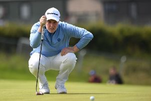 Bob MacIntyre lines up a putt at Royal Portrush