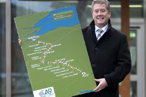 MSP Keith Brown with a map of the A9 dualling project