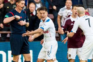Ian Black remonstrates with the official during a 2-0 Rangers loss at Tynecastle.