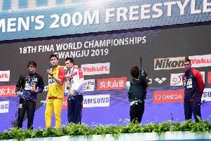 Duncan Scott, right, refuses to acknowledge Sun Yang after his 200m freestyle victory