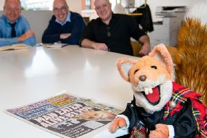 Basil Brush at morning conference, guest editing the Evening News