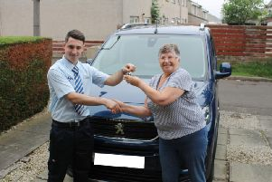 Assembler Scott Kane delivers a vehicle to Janet Grant and her husband Jim. Picture: contributed