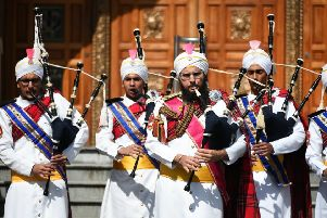 The Sri Dasmesh Pipe Band, a Malaysian Sikh Band, tunes up outside the Gurdwara Singh Sabah temple in Glasgow ahead of their performances at Pipping Live! and the World Pipe Band Championships PIC: John Devlin