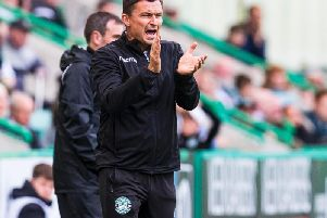 Paul Heckingbottom tries to get his instructions over to his Hibs team.