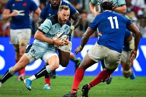 Sotland winger Byron McGuigan comes up against France debutant Alivereti Raka. Picture: Pascal Guyot/AFP/Getty Images