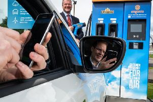 Scott Mathieson (left) and Mike Gill test drive the WattsUp app. Picture: contributed
