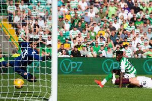 Vakoun Bayo looks on as the ball finds the back of the net past Hearts goalkeeper Joel Pereira.
