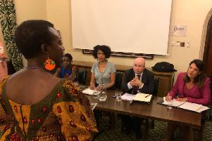 A member of the public sharing her frustrations with the then Immigration Minister Caroline Nokes MP. Also pictured are (L to R): Dr Robtel Neajai Pailey, Chi Onwura MP and Patrick Grady MP.